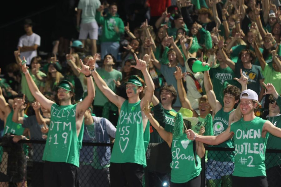 On the Sept. 24 senior night football game against Hazelwood West, students cheer in Lafayettes student section. The theme for the game was green-out in support of mental health awareness. Oct. 10 is World Mental Health Day.