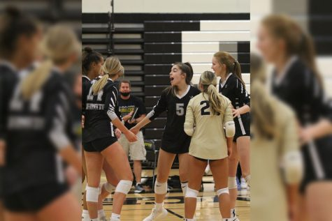 Senior Page Borgmeyer rallies her teammates during a game against St. Jospehs Academy on Sept. 28. Borgmeyer and the team won that game, as well as all their games since, culminating in eleven consecutive victories.