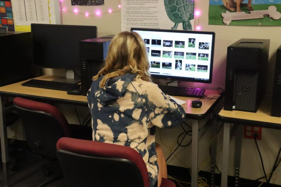 In preparation for the 2021-2022 yearbook, Legend sports editor senior Paige Halter works on one of her assignments. Yearbooks are typically finished at the end of a school year and are given to students around the beginning of the following school year.