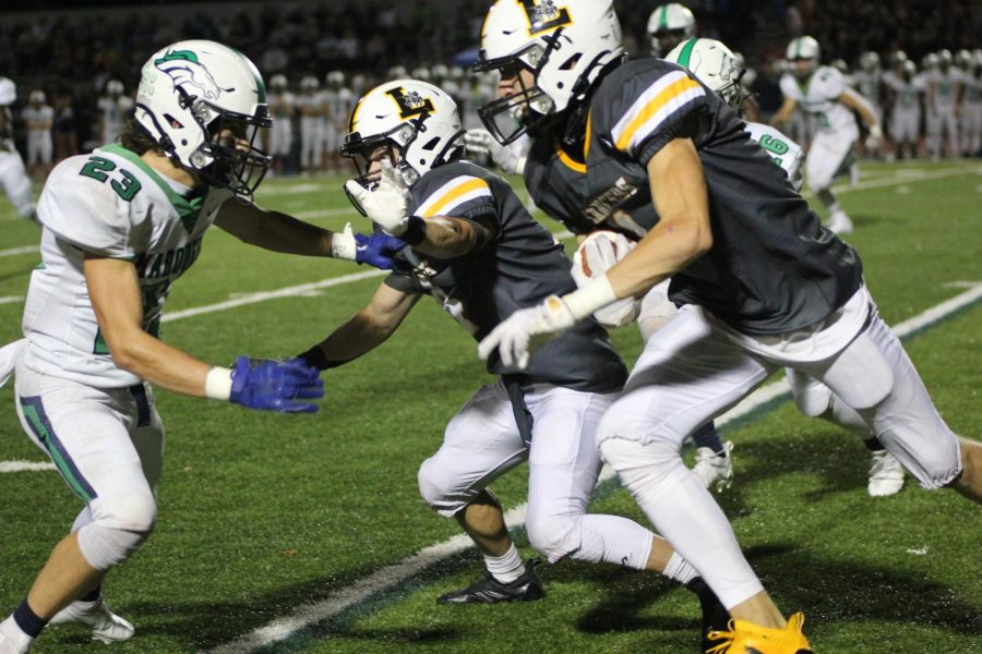 The Lancers run an offensive play against the Mustangs. The Homecoming Game was an unforgettable experience, and while I wish the outcome would have been different. I know every player gave it their all, senior Jack Clark, lineman, said.