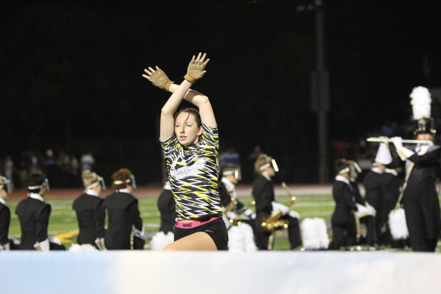 Senior Isabella Hall performs with her Lancer Regiment bandmates as they perform their halftime show, Virtual Reality. It was fun to go to the game and see everyone there because Homecoming is such a community event. The game just brings so much life to our field and support for our different activities. When performing, its amazing seeing so many people there knowing that they havent seen our show before, so it pushed us to give an even better performance, senior Lancer Regiment member Elena Mendoza said.