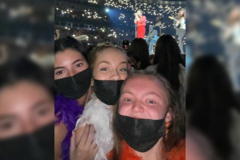 Seniors Nikki Linsenbardt, Kate Fischer and Bella Vollmer watch the Harry Styles concert from their pit seats in Chicago on Sept. 25, 2021. Styles show, Love On Tour, is moving across North America, having started in Las Vegas, Nevada on Sept. 4 and will conclude in Inglewood, California on Nov. 20.